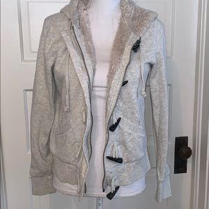 Beige/cream Roxy Zip up hoodie with faux fur.